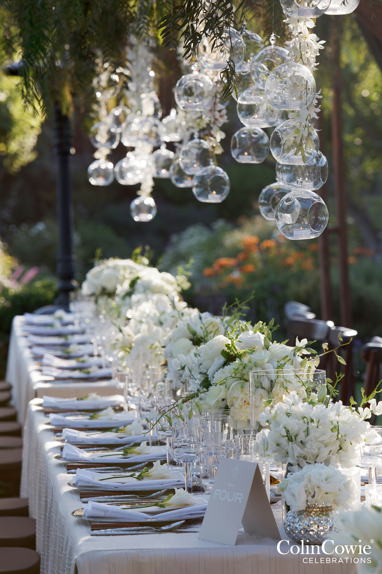 Banquet tables set for an outdoor welcome dinner