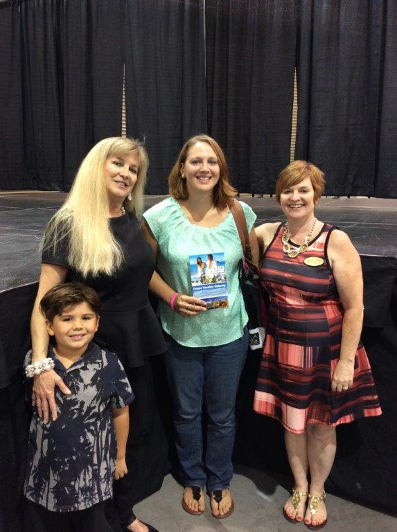This bride won a 7 day honeymoon. Pictured with Virginia Bride Publisher Angeline Frame and Bridal Registry vendor Donna Loving who contributed the prize.